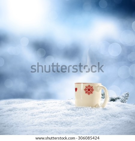 blurred background of winter frost and tea and mug space  - stock photo