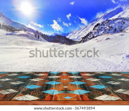 Blurred background of winter landscape with wooden deck