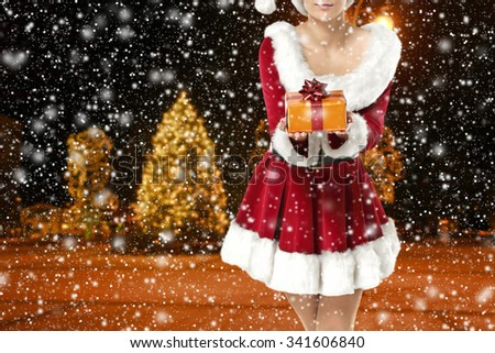 blurred background of winter night and golden box  - stock photo