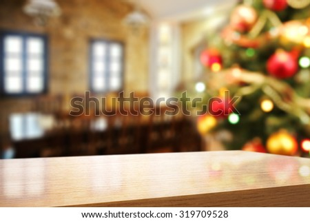 blurred background of xmas tree and yellow wooden deks space of free  - stock photo