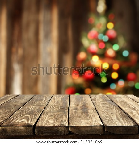 Blurred background xmas tree lights wall stock photo edit now blurred background of xmas tree lights and wall with table of brown color aloadofball Image collections