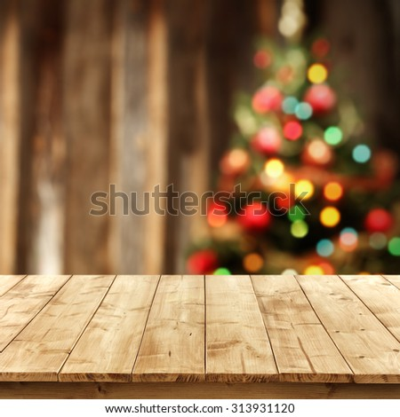 Blurred background xmas tree lights wall foto de stock libre de blurred background of xmas tree lights and wall with yellow wooden table and bokeh space aloadofball Image collections