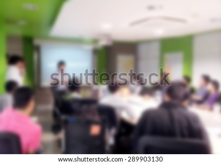 Blurred background : people brainstorm in a meeting room