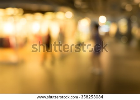 Blurred background : people shopping at market fair  - stock photo