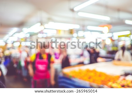 Blurred background : people shopping at market fair in sunny day, blur background with bokeh - stock photo