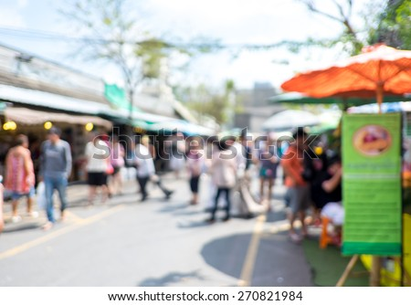 Blurred background : people shopping at market fair in sunny day, blur background with bokeh. - stock photo