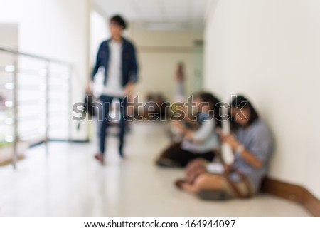Blurred background : people sit on the floor