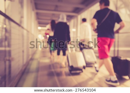 Blurred background : People walking in the airport with retro filter effect - stock photo