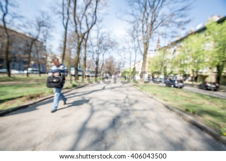 blurred background. people walking on a city street. street on a spring day
