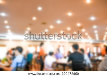 blurred background - restaurant customers business leisure enjoy food table chairs union together - stock photo