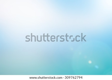 blurred background sea lake ray flare light.blur backdrop concept.pastel  tone color.blurry colorful of blue gradient image:bright sunshine day summer season:holiday vacation ideal image:arctic sun - stock photo