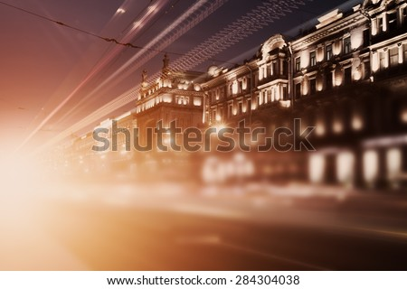 blurred background, speed motion in a night city - stock photo