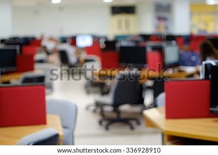 Blurred background table work in computer centre.abstract blurre