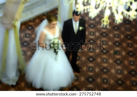 Blurred background - the bride and groom at the wedding ceremony, marriage ceremony - stock photo