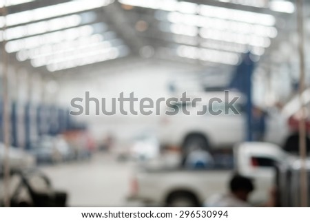 Blurred background the car in garage  - stock photo