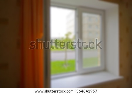 Blurred background. The view from the window of the residential area, the house. Applied lighting effects. The entire frame is blurred.
