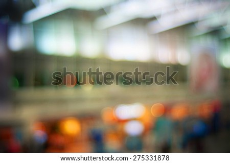 Blurred background : Traveler at airport terminal blur background with bokeh light - stock photo
