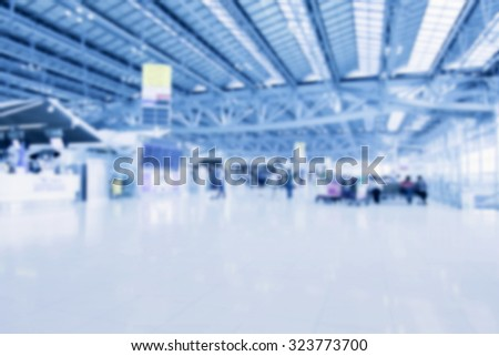 Blurred background : Traveler at airport terminal blur background with bokeh light,Vintage filter. - stock photo