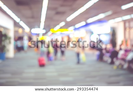 Blurred background : Traveler with baggage at airport terminal blur background with bokeh light - stock photo