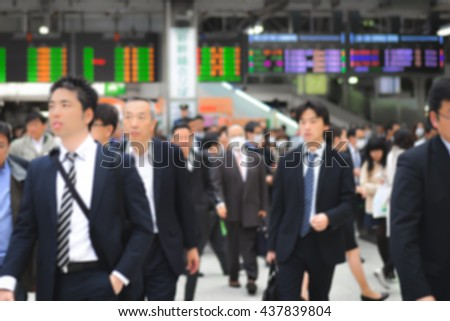 Blurred background: Unidentified people travel at Ueno train station, Tokyo, Japan - Circa April 2016 - stock photo