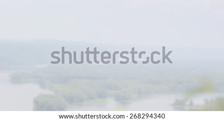 Blurred Background Water and Woods overlooking river from high above. - stock photo