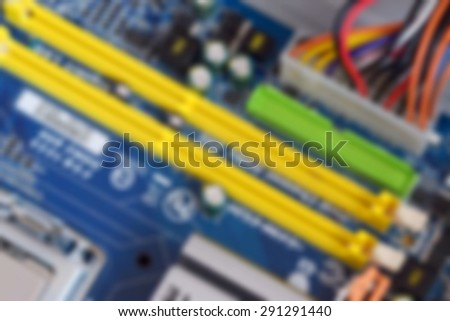Blurred background with computer components - stock photo