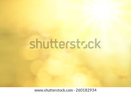 Blurred Background with golden lens flares and sunshine. - stock photo