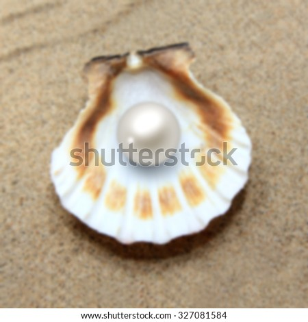 Blurred background with sea shells and pearl - stock photo