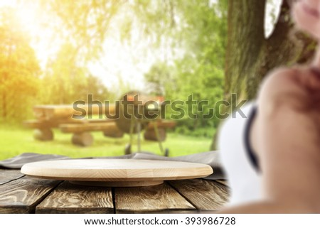 blurred background with young woman and wooden deck space  - stock photo