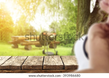 blurred background with young woman and worn table  - stock photo