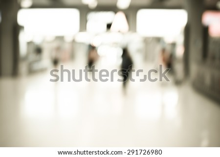 Blurred background : Woman traveler walk in to terminal at airport terminal departure blur background with bokeh light. - stock photo