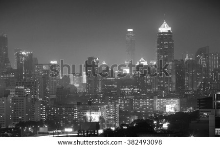 Blurred Bangkok city scape, View high building in the business district at night Bangkok ,Thailand