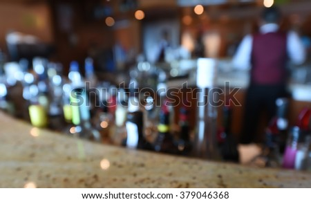 Blurred Bar with Bottle of Booze with Instagram Style Filter - stock photo