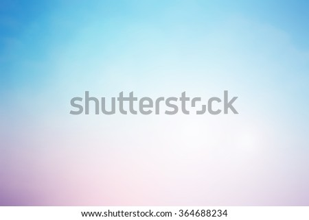 blurred beautiful natural landscape background with ray flare lights.blurry sunshine wallpaper concept.backdrop pastel tone.idyllic shores sundown hours.abstract dream magic coastline dramatic image. - stock photo