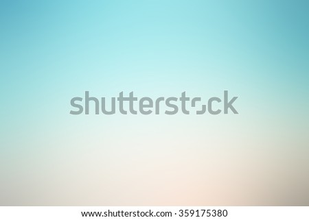 blurred beautiful natural sky landscape background with ray flare lights.blurry sunshine wallpaper concept.backdrop pastel cool tone.idyllic shores sundown hour.abstract dream magic coastline dramatic - stock photo