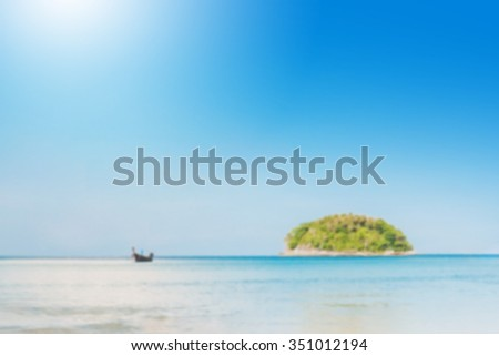 blurred beautiful seascape with blue sea beach island and the long tail boat under clear sky in summer ,kata beach - phuket - stock photo