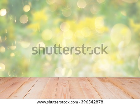 Blurred beautiful spring background with wooden background - stock photo