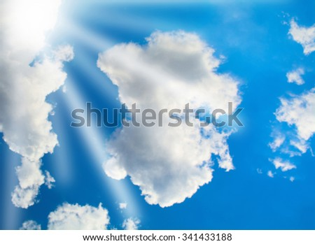 blurred blue sky with clouds and sun - stock photo