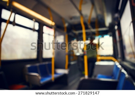 Blurred blurry soft focus background, interior of empty bus with nobody in it