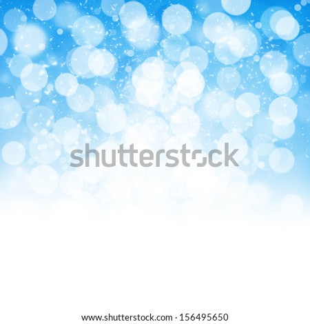 Blurred bokeh abstract nature background with snow flakes