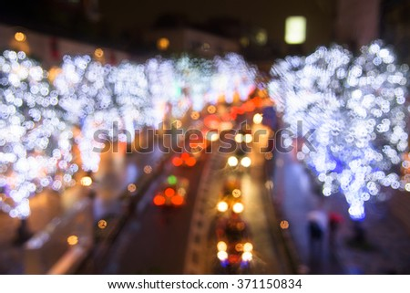 Blurred bokeh abstract of Winter tree Illumination and traffic - stock photo