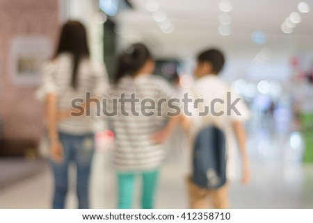 Blurred bokeh and people in shopping mall for background