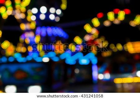 Blurred bokeh carousel lights background - stock photo