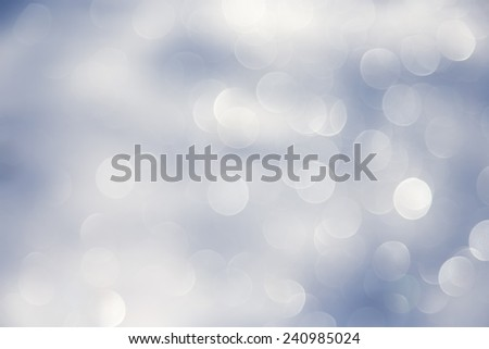 Blurred bokeh christmas background with snowflakes - stock photo