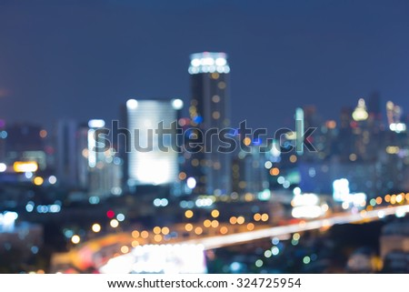 Blurred bokeh city light at night - stock photo