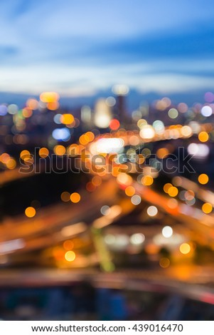 Blurred bokeh lights city downtown background and highway intersection skyline - stock photo