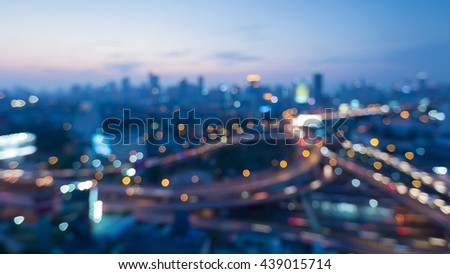 Blurred bokeh lights city interchanged and city downtown background night view - stock photo