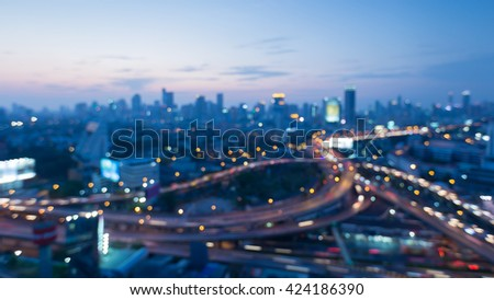Blurred bokeh lights, Highway interchanged and city downtown background after sunset - stock photo