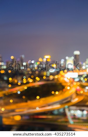 Blurred bokeh lights, Intersection highway and city downtown background, night view - stock photo