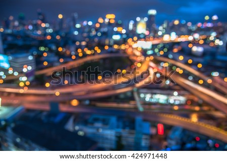 blurred bokeh lights of city downtown background and highway - stock photo